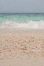 Beach sand and sea water getting wet by the Stock Photography