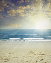 Beach sand surf and sun scenery Stock Images
