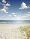 Beach sand water and sky scenery Royalty Free Stock Images