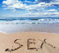 Beach with sand word sex sea Royalty Free Stock Photo