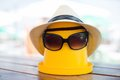 The beach scene with bucket and sunglasses hat Royalty Free Stock Image