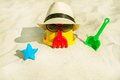 Beach scene with children toys the bucket and sunglasses Stock Photography
