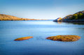 Beach scenery in norway with blue sky hvaler Stock Photos
