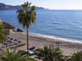 Beach scenes in nerja a resort on the costa del sol near malaga andalucia spain europe sleepy spanish holiday Stock Images