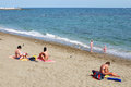 Beach sea sand women enjoying the sun and children playing on the marbella costa del sol spain Stock Photography