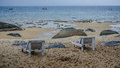 Beach shezlong a photo of two chairs or sunbathe chairs on the some rocks and boats are in the view Royalty Free Stock Photo