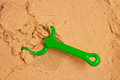 A beach shovel and a beach rake on the sand close up Royalty Free Stock Photography