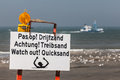 Beach sign warning for quicksand Royalty Free Stock Photo