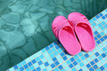 Beach slippers on pool side Royalty Free Stock Photos