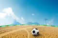 Beach soccer ball on sand in summer time Royalty Free Stock Photos