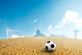 Beach soccer ball on sand in summer time Stock Photography