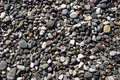 Beach stones coastal of different shizes shapes and colors forming a homogeneous patchwork Stock Photo