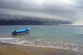 Beach and storm with threatening clouds a boat coming from the caribbean sea costa rica Stock Images