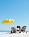 Beach summer umbrella kiss Royalty Free Stock Photo