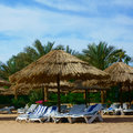Beach with sun loungers and parasols Royalty Free Stock Photos