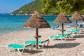 Beach sunbeds empty and umbrellas at majorca mallorca resort in formentor Stock Photography