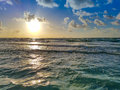 Beach Sunrise, Ocean Waves, Clouds and Blue Sky Royalty Free Stock Photo