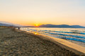 Beach on sunset in village kavros in crete island greece magical turquoise waters lagoons travel background Royalty Free Stock Image