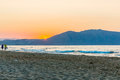 Beach on sunset in village kavros in crete island greece magical turquoise waters lagoons travel background Stock Photos
