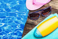 Beach supplies for the recreational on wooden floor Stock Images