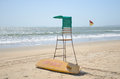 Beach surf rescue surfboard flag and chair Stock Images
