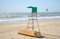 Beach surf rescue surfboard flag and chair Royalty Free Stock Photos