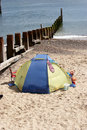 Beach tent at water edge Royalty Free Stock Photography