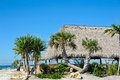 Beach tiki hut bar on the ocean Stock Photo