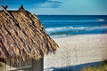 Beach Tiki Hut Bar on the Ocean Royalty Free Stock Photo