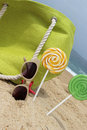 Beach time straw green bag and sunglasses on the sandy Royalty Free Stock Photos