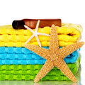 Beach Towels With Starfish And Sunscreen Stock Photos