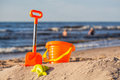 Beach toy set at coast orange sunny Royalty Free Stock Photography