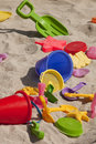 Beach toys colorful plastic in the sand Royalty Free Stock Photography