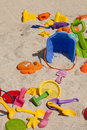 Beach toys colorful plastic in the sand Stock Photo