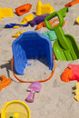 Beach toys colorful plastic in the sand Royalty Free Stock Photo