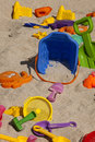 Beach toys colorful plastic in the sand Stock Images