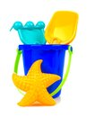 Beach toys over white toy sand pail with rake shovel and starfish a background Stock Images