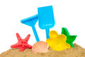 Beach toys in sand isolated on white background Stock Image