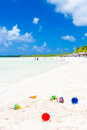 Beach toys in the sand of a tropical beach in cuba at cayo coco coco key on summer day with puffy white clouds on blue sky Stock Photo