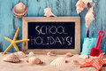 Beach toys, seashells, starfishes and text school holidays Royalty Free Stock Photo