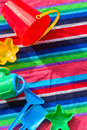 Beach toys on towel Royalty Free Stock Photo