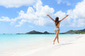 Beach travel vacation holidays bikini girl happy and concept with running full of joy and aspiration on pristine beautiful Stock Photos