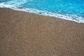 Beach tropical with brown sand and clear water Royalty Free Stock Photo