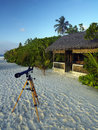 Beach in the tropical paradise of the maldives telescope at a luxury resort Stock Photo