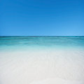 Beach and tropical sea with blue sky Royalty Free Stock Photos
