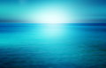 Beach and tropical sea with bright sun an abstract seascape Stock Photos