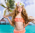 Beach tropical vacation kid blond girl with fashion flowers in head and palm tree vintage color Royalty Free Stock Photography