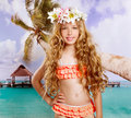 Beach tropical vacation kid blond girl with fashion flowers in head and palm tree vintage color Royalty Free Stock Photo