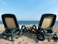 Beach two empty chairs on sea Stock Images
