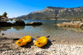 Beach two single kayaks on the seascape background, active rest by the sea concept. Royalty Free Stock Photo